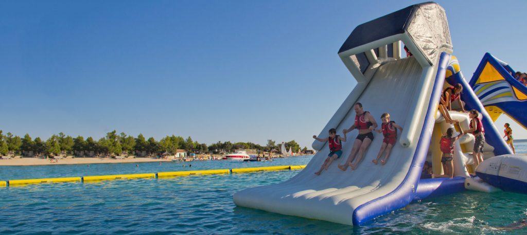A man and two children on a Freefall-supreme waterslide.